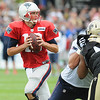 Rick Barbero/The Register-Herald<br /> Tom Brady fades back for a pass during the New Orleans Saints and New England Patriots joint practice held at The Greenbrier Resort in White Sulphur Springs Thursday morning.