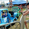 Rick Barbero/The Register-Herald<br /> Gloria Beverage, of Lewisburg, right, gives her son Cooper Beverage, 4, the thumbs up during his truck ride at zThe WV State Fair in Fairlea.