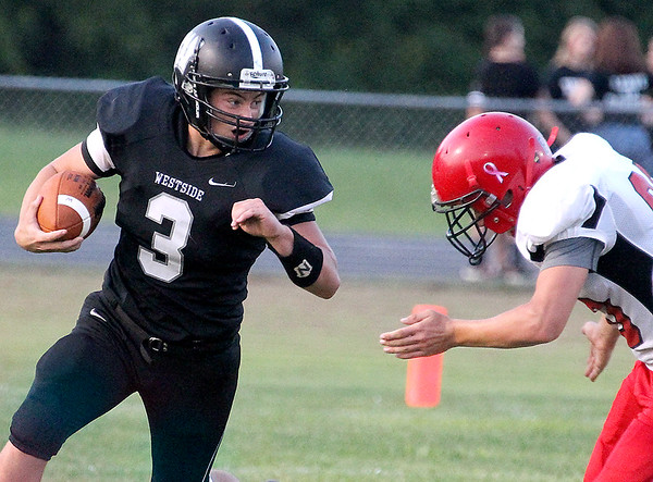 Brad Davis/The Register-Herald<br /> Westside's Josh Morgan carries the ball against Liberty Friday night in Clear Fork.