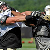 Brad Davis/The Register-Herald<br /> Guard Mike McGlynn, left, battles with defensive lineman Kaleb Eulls during drills at New Orleans Saints practice Saturday morning in White Sulphur Springs.