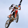 Brad Davis/The Register-Herald<br /> Philadelphia, PA's Jake Goodyear defies gravity with a mid-air stunt during an FMX Motocross event Sunday afternoon at the State Fair in Fairlea. A handful of different freestyle moto cross riders from different parts of the country traveled to the state to take part in the event, which featured big air tricks off a giant ramp.