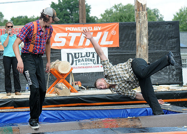 Rick Barbero/The Register-Herald<br /> Tyler Aldean, left, watches Rory Rosenberker fall in the water during the lumberjack show at the WV State Fair in Fairlea.