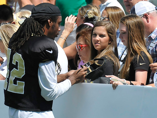 Brad Davis/The Register-Herald<br /> Safety Pierre Warren signs autographs for fans following New Orleans Saints practice Saturday morning in White Sulphur Springs.
