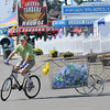 Rick Barbero/The Register-Herald<br /> Matthew Tate collecting recycling bottles and cans on his bike at the State Fair of West Virgina in Fairlea.