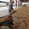 Brad Davis/The Register-Herald<br /> Exchange resident Victor Friend of Friend Brothers Limousin prepare the area where their cattle will be displayed in the livestock arena section of the State Fairgrounds Wednesday afternoon in Fairlea.
