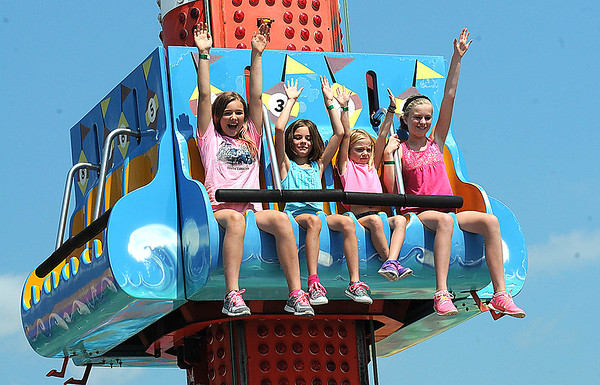 Rick Barbero/The Register-Herald<br /> Children enjoying the rides at The WV State Fair in Fairlea.