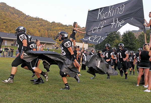 Brad Davis/The Register-Herald<br /> The Renegades burst onto the field prior to Westside's game against Liberty Friday night in Clear Fork.
