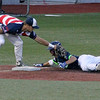 Brad Davis/The Register-Herald<br /> West Virginia third baseman Dan Ward tags out Jammers baserunner Bram Johnson during the Miners' final regular season home game against Jamestown Wednesday night at Linda K. Epling Stadium.
