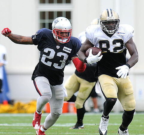 Rick Barbero/The Register-Herald<br /> Patrick Chung, of Patriots, left, going after Benjamin Watson, of Saints, during the New Orleans Saints and New England Patriots joint practice held at The Greenbrier Resort in White Sulphur Springs Wednesday morning.
