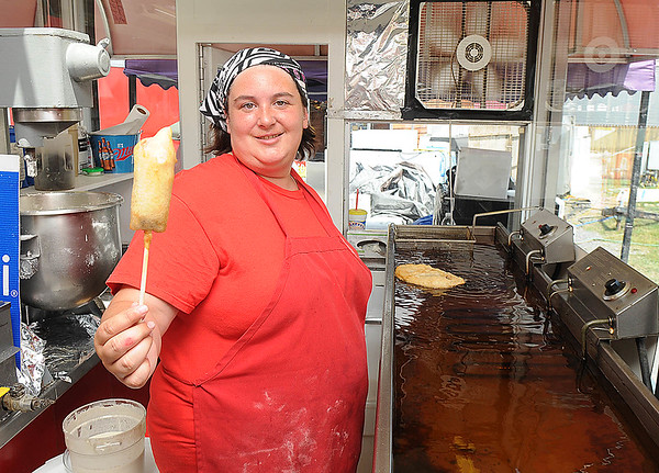 Rick Barbero/The Register-Herald<br /> Heather Barnette holding up a deep fried Milky Way at the State Fair of West Virgina in Fairlea.
