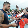 Rick Barbero/The Register-Herald<br /> Michael Hoomanawanui, of New England signs autographs after the New Orleans Saints and New England Patriots joint practice held at The Greenbrier Resort in White Sulphur Springs Thursday morning.