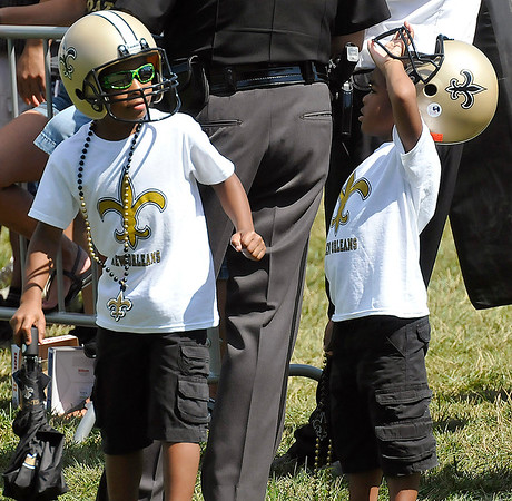 Brad Davis/The Register-Herald<br /> Young fans Sacoris Bowie (left), 7, and his little brother Xarion, 5, patiently wait for their favorite players to come over for photos and autographs following New Orleans Saints practice Saturday morning in White Sulphur Springs.