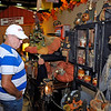 Brad Davis/The Register-Herald<br /> Clear Creek resident Kenneth Painter looks over craft items available at The Carpenter's Loft booth inside the Beckley-Raleigh County Convention Center Saturday afternoon during the Appalachian Arts & Crafts Fair.