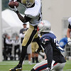 Rick Barbero/The Register-Herald<br /> Brandin Cooks, of Saints, leeps in the air and pulls in a catch during the New Orleans Saints and New England Patriots joint practice held at The Greenbrier Resort in White Sulphur Springs Wednesday morning.