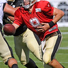 Brad Davis/The Register-Herald<br /> Quarterback Drew Brees hands the ball off during drills at New Orleans Saints practice Saturday morning in White Sulphur Springs.