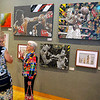"""Brad Davis/The Register-Herald<br /> Art enthusiasts Nancy Moran (right) and Cheryl Hartley chat as they view works on display Sunday afternoon at Tamarack's newest juried exhibit, """"Transforming Tradition,"""" which runs until September 27."""