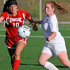 Brad Davis/The Register-Herald<br /> Woodrow Wilson's Kaitlyn Sweeney battles for possession with Hurricane's Carly Cunningham Thursday evening at the YMCA Paul Cline Memorial Sports Complex.