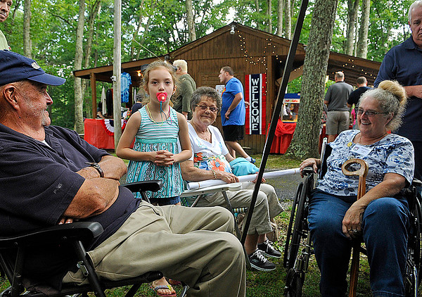 Brad Davis/The Register-Herald<br /> Young Madelyn Lilly, 7, notices the camera as she goofs off with family members Mildred Lilly, middle, and Ginger Lilly, right, during the annual Lilly Family Reunion August 8.