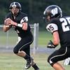Brad Davis/The Register-Herald<br /> Westside quarterback Larry Cook Jr. looks for an open receiver Friday night in Clear Fork.