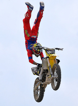 Brad Davis/The Register-Herald<br /> Rider Mike Mason twirls through the air before a huge crowd during an FMX Motocross event Sunday afternoon at the State Fair in Fairlea.