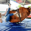 Rick Barbero/The Register-Herald<br /> Brittani Bible, of Petersburg, WV, gets thrown from a mechnical Bull at The WV State Fair in Fairlea.
