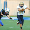 Rick Barbero/The Register-Herald<br /> Keith Sexton, of Shady Spring, right, breaks away from, Kevin Phillips, of Princeton, in the first half at Hunnicut Stadium in Princeton Friday night.