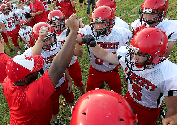 Brad Davis/The Register-Herald<br /> The Raiders get fired up on the sideline prior to kickoff Friday night in Clear Fork.