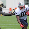 Rick Barbero/The Register-Herald<br /> Jimmay Mundine, of Patriots, right, breaks loose for some extra yards during the New Orleans Saints and New England Patriots joint practice held at The Greenbrier Resort in White Sulphur Springs Wednesday morning.