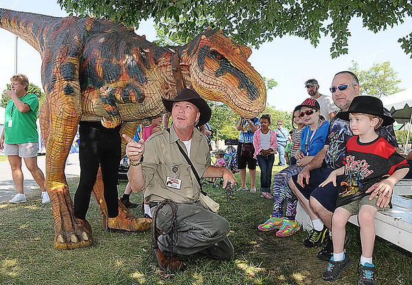 Rick Barbero/The Register-Herald<br /> Jack Cage talking about Buster the T-Rex at the State Fair of West Virginia. Rixie is totally realistic puppet that stands over 8' tall and 12' long performing daily at the fair.
