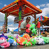 Brad Davis/The Register-Herald<br /> Tampa, Florida's Dennis Hendricks organizes a massive pile of stuffed animals as he prepares his booth for this year's State Fair Wednesday afternoon in Fairlea.