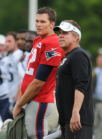 Rick Barbero/The Register-Herald<br /> Patriots quarterback Tom Brady, left, stands on the sideline with Saints coach Sean Payton during the New Orleans Saints and New England Patriots joint practice held at The Greenbrier Resort in White Sulphur Springs Thursday morning.