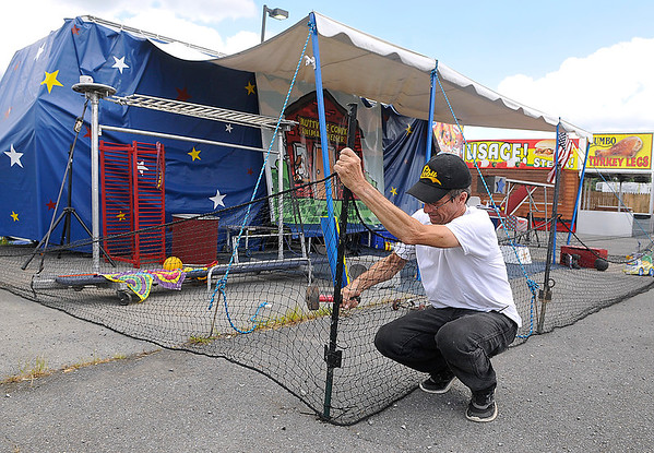Brad Davis/The Register-Herald<br /> Bradenton, Florida resident Johnny Peers, returning to the State Fair for the first time in 13 years, sets up his Muttville Comix Animal Shelter, a place where patrons can see dog comedy shows Wednesday afternoon in Fairlea.
