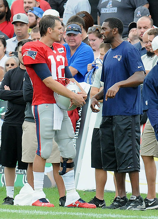 Rick Barbero/The Register-Herald<br /> Tom Brady, of New England, left, speaks with former NFL star Randay Moss during the New Orleans Saints and New England Patriots joint practice held at The Greenbrier Resort in White Sulphur Springs Thursday morning.