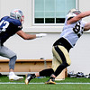 Rick Barbero/The Register-Herald<br /> Josh Hill, of Saints, right, pulls in a catch well being defended by Nate Ebner, of Patriots during the New Orleans Saints and New England Patriots joint practice held at The Greenbrier Resort in White Sulphur Springs Wednesday morning.