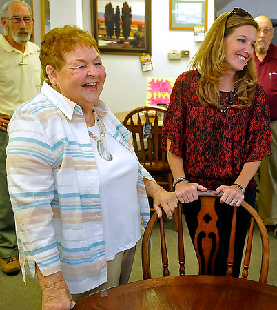 Brad Davis/The Register-Herald<br /> Darnell Furniture Owner Jeannie Darnell, left, reflects on her time serving the community in the furniture business through the years with friend Becky Bolton, right, among several others following a press conference Thursday afternoon in MacArthur.