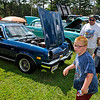 Brad Davis/The Register-Herald<br /> Seven-year-old Christopher Smith, near, his brother Matthew, 6, and dad Aaron check out a few rides during the Summersville Lake Lighthouse Festival Saturday afternoon in Mount Nebo.