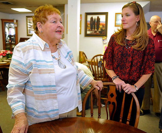 Brad Davis/The Register-Herald<br /> Darnell Furniture Owner Jeannie Darnell, left, reflects on her time serving the community in the furniture business through the years with friend Becky Bolton following a press conference Thursday afternoon in MacArthur.