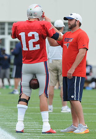 Rick Barbero/The Register-Herald<br /> Tom Brady, of Patriots, left,  preparing for the New Orleans Saints and New England Patriots joint practice at The Greenbrier Resort in White Sulphur Springs Wednesday morning.