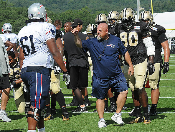 Rick Barbero/The Register-Herald<br /> Patriots line coach Dave DeGuglielmo giving instructions to his players during the New Orleans Saints and New England Patriots joint practice held at The Greenbrier Resort in White Sulphur Springs Wednesday morning.