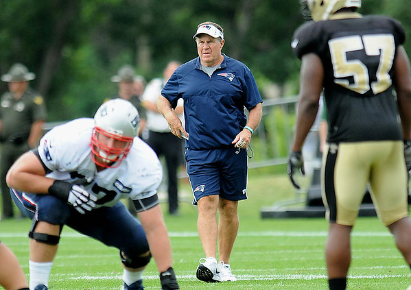 Rick Barbero/The Register-Herald<br /> New England's head coach Bill Belichick watches his team during the New Orleans Saints and New England Patriots joint practice held at The Greenbrier Resort in White Sulphur Springs Thursday morning.