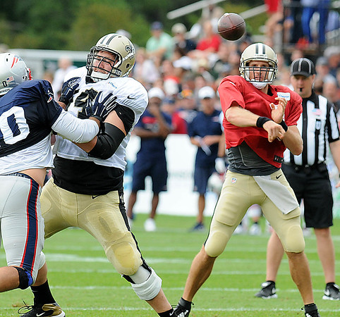 Rick Barbero/The Register-Herald<br /> Drew Bress, of New Orleans throws a pass duting the New Orleans Saints and New England Patriots joint practice held at The Greenbrier Resort in White Sulphur Springs Thursday morning.