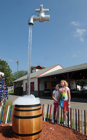 Rick Barbero/The Register-Herald<br /> Lauren Kubecki, 7, of Winston Salem, NC, and Hazel Tincer, 8, of Clayton, WV, look over a display by Advanced Water Treatment at The WV State Fair in Fairlea.