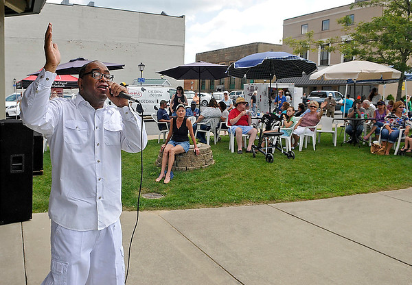 """Brad Davis/The Register-Herald<br /> Singer Ronnie """"Diamond"""" Hoard, left, entertains the crowd at Word Park as he performs during the Simply Jazz & Blues Festival Friday afternoon in Beckley."""