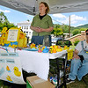 Brad Davis/The Register-Herald<br /> Hinton residents Dwight and Linda Emrich man the Great Rubber Ducky Race sign-up table during the State Water Festival Saturday afternoon in downtown Hinton.