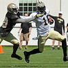 Brad Davis/The Register-Herald<br /> Receiver Brandon Coleman, right, uses a stiff-arm to try and avoid the tackle from safety Kenny Phillips during drills at New Orleans Saints practice Saturday morning in White Sulphur Springs.