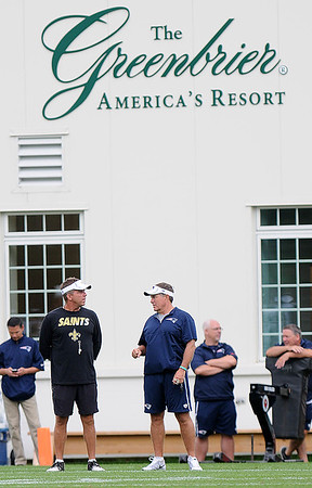 Rick Barbero/The Register-Herald<br /> Saints coach Sean Payton, and Patriots Bill Belichick speak during the New Orleans Saints and New England Patriots joint practice held at The Greenbrier Resort in White Sulphur Springs Thursday morning.