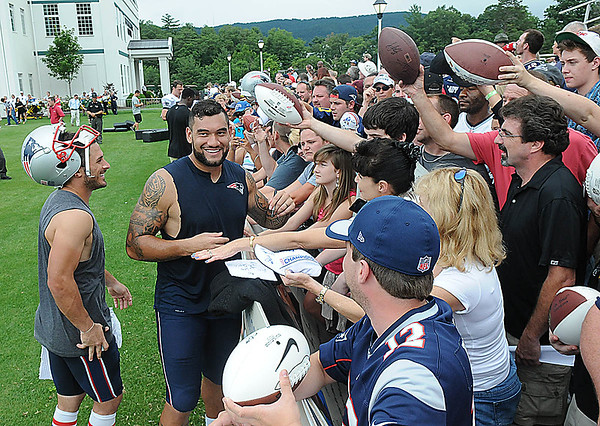 Rick Barbero/The Register-Herald<br /> Danny Amendola, left, and Michael Hoomanawanui, of New England signing autographs after practice at The Greenbrier Resort.