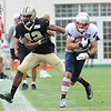 Rick Barbero/The Register-Herald<br /> Danny Amendola, of New England, right, breaks away from Pierre Warren, of New Orleans during the New Orleans Saints and New England Patriots joint practice held at The Greenbrier Resort in White Sulphur Springs Thursday morning.