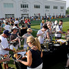 Brad Davis/The Register-Herald<br /> Fans fill up on hot dogs and hamburgers during the Picnic with the Saints event following practice Sunday afternoon in White Sulphur Springs.
