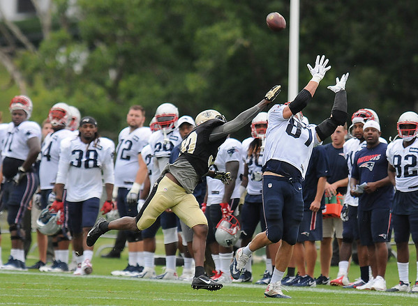 Rick Barbero/The Register-Herald<br /> Kenny Phillips, of New Orleans, left, tries to break up a pass against Danny Amendola during the New Orleans Saints and New England Patriots joint practice held at The Greenbrier Resort in White Sulphur Springs Thursday morning.